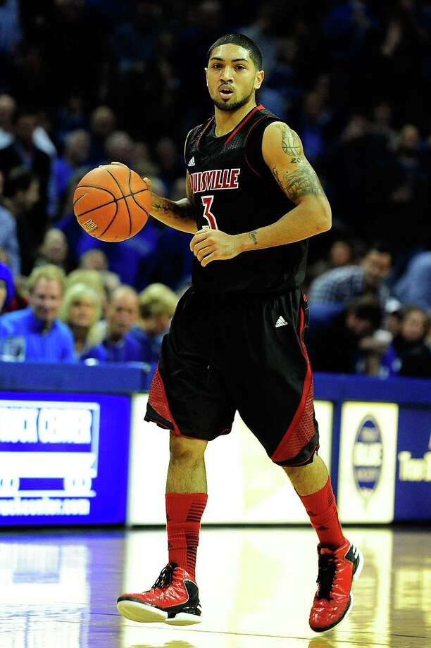 Peyton Siva #3 of the Louisville Cardinals brings the ball up the court against the Memphis Tigers during a game at FedExForum on Dec.15, 2012 in Memphis, Tenn. Photo: Stacy Revere, Getty Images / 2012 Getty Images