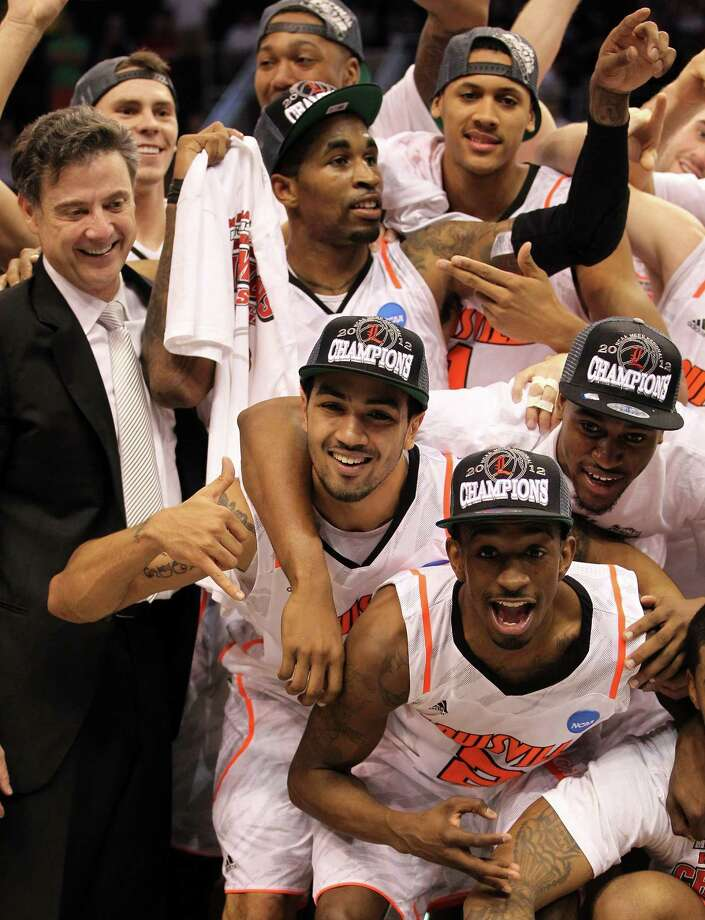 Head coach Rick Pitino, Peyton Siva #3 and Russ Smith #2 of the Louisville Cardinals celebrate after defeating the Florida Gators 72-68 during the 2012 NCAA Men's Basketball West Regional Final at US Airways Center on March 24, 2012 in Phoenix, Ariz. Photo: Jamie Squire, Getty Images / 2012 Getty Images