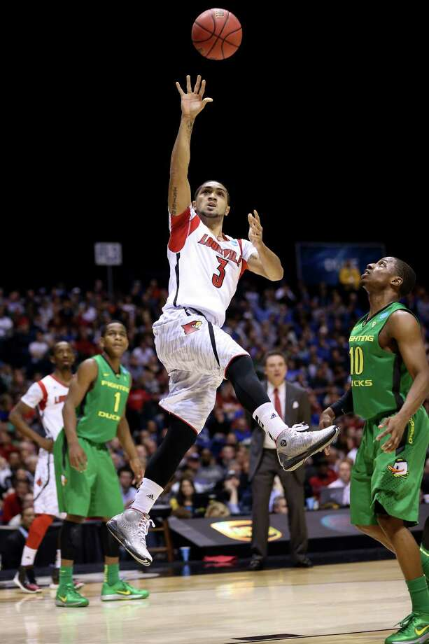 Peyton Siva #3 of the Louisville Cardinals drives for a shot attempt in the second half against the Oregon Ducks during the Midwest Region Semifinal round of the 2013 NCAA Men's Basketball Tournament at Lucas Oil Stadium on March 29, 2013 in Indianapolis, Ind. Photo: Streeter Lecka, Getty Images / 2013 Getty Images