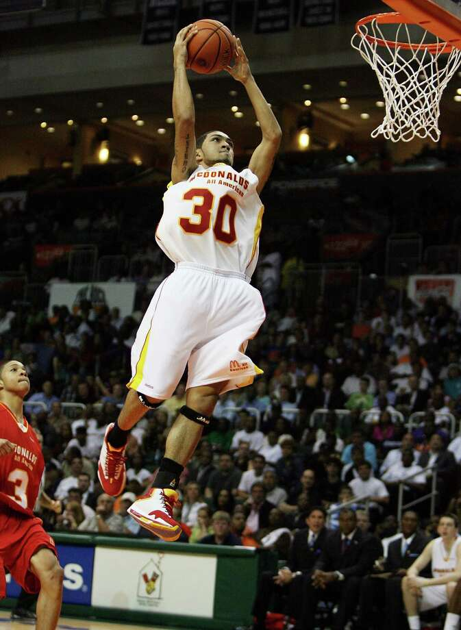 Peyton Siva #30 of the East Team finishes a 360 layup against the West Team in the 2009 McDonald's All American Men's High School Basketball Game at BankUnited Center on April 1, 2009 in Coral Gables, Fla. Photo: Doug Benc, Getty Images / 2009 Getty Images