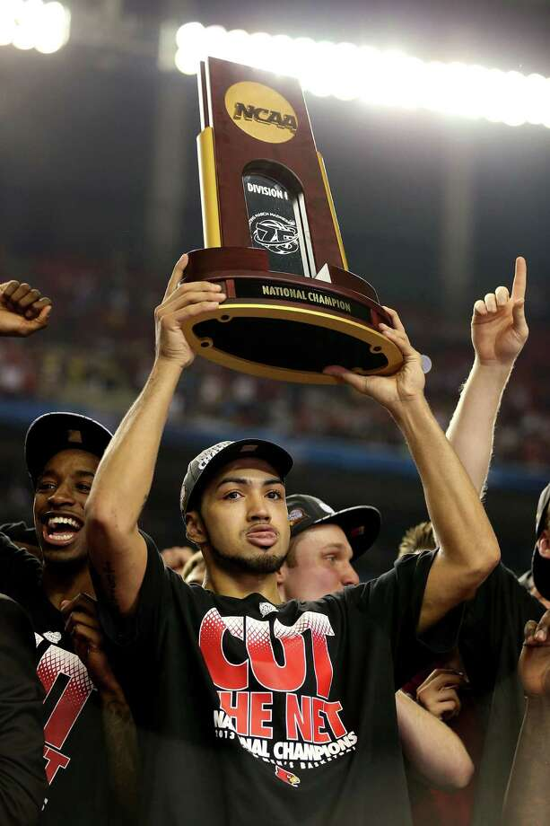 Peyton Siva #3 of the Louisville Cardinals celebrates with the National Championship trophy after they won 82-76 against the Michigan Wolverines during the 2013 NCAA Men's Final Four Championship at the Georgia Dome on April 8, 2013 in Atlanta, Ga. Photo: Andy Lyons, Getty Images / 2013 Getty Images
