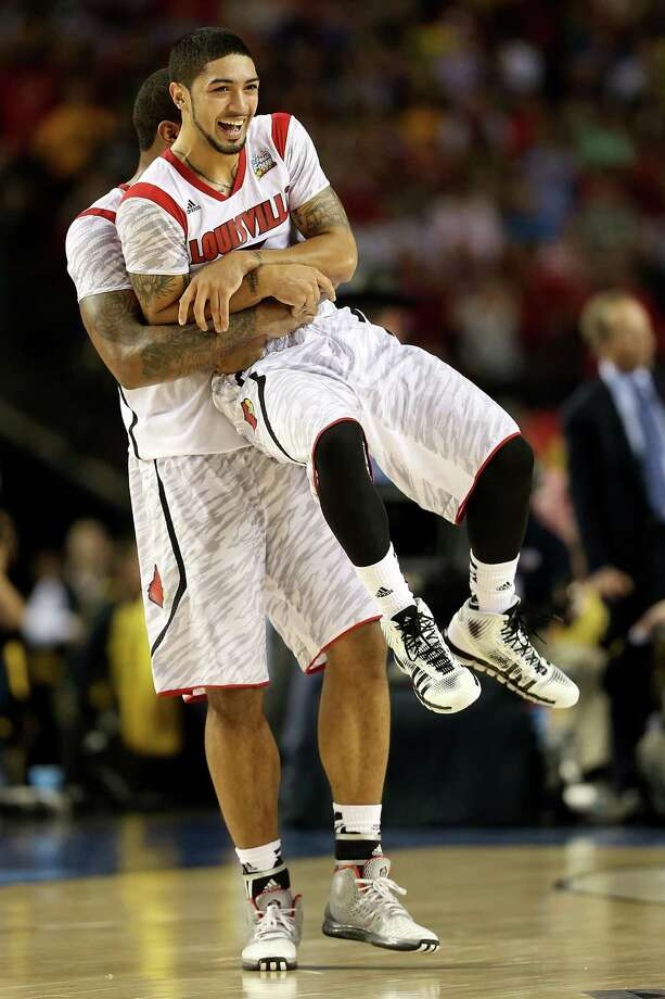 Chane Behanan #21 and Peyton Siva #3 of the Louisville Cardinals celebrate their 82-76 win against the Michigan Wolverines during the 2013 NCAA Men's Final Four Championship at the Georgia Dome on April 8, 2013 in Atlanta, Ga. Photo: Andy Lyons, Getty Images / 2013 Getty Images