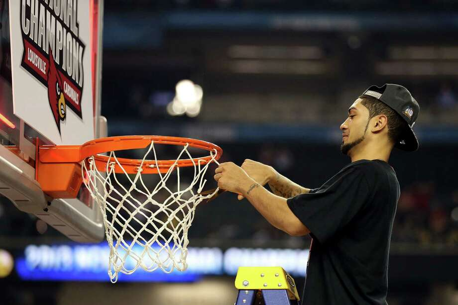 Peyton Siva #3 of the Louisville Cardinals cuts down a piece of the net in celebration of Louisville's 82-76 win against the Michigan Wolverines during the 2013 NCAA Men's Final Four Championship at the Georgia Dome on April 8, 2013 in Atlanta, Ga. Photo: Andy Lyons, Getty Images / 2013 Getty Images