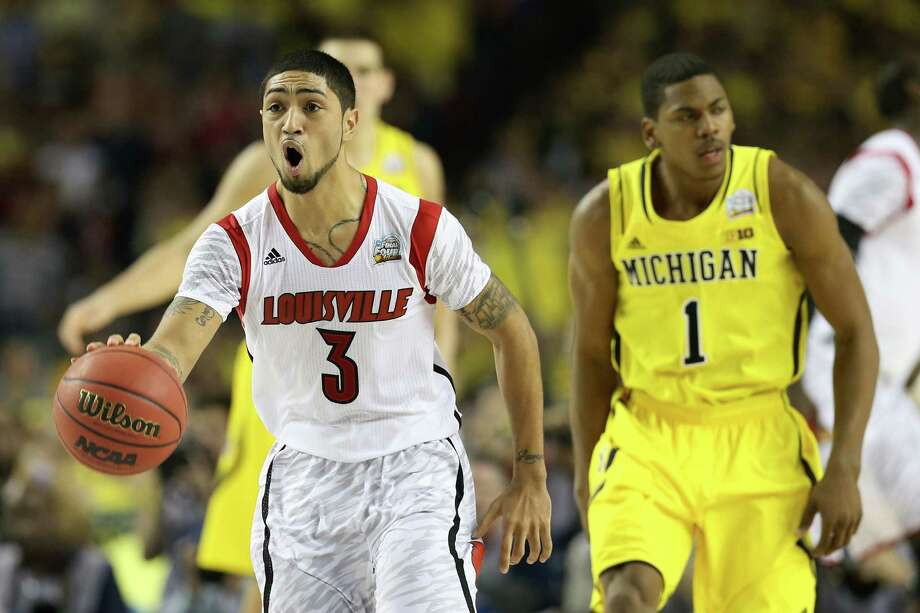 Peyton Siva #3 of the Louisville Cardinals reacts in the seocnd half against Glenn Robinson III #1 of the Michigan Wolverines during the 2013 NCAA Men's Final Four Championship at the Georgia Dome on April 8, 2013 in Atlanta, Ga. Photo: Streeter Lecka, Getty Images / 2013 Getty Images