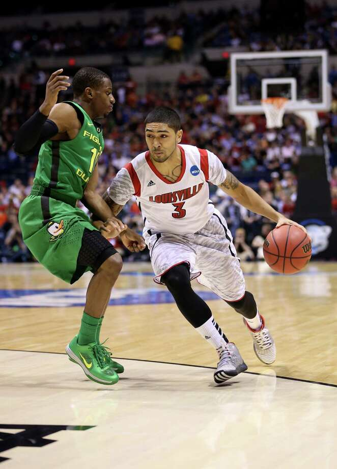 Peyton Siva #3 of the Louisville Cardinals drives against the Oregon Ducks during the Midwest Region Semifinal round of the 2013 NCAA Men's Basketball Tournament at Lucas Oil Stadium on March 29, 2013 in Indianapolis, Ind. Photo: Streeter Lecka, Getty Images / 2013 Getty Images