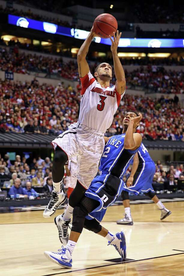 Peyton Siva #3 of the Louisville Cardinals drives for a shot attempt against Quinn Cook #2 of the Duke Blue Devils during the Midwest Regional Final round of the 2013 NCAA Men's Basketball Tournament at Lucas Oil Stadium on March 31, 2013 in Indianapolis, Ind. Photo: Andy Lyons, Getty Images / 2013 Getty Images