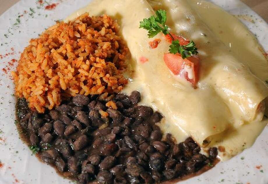 Chicken enchiladas at Bandos in Beaumont. Guiseppe Barranco/cat5