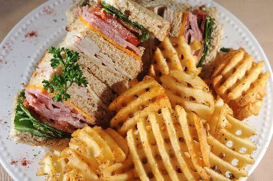 Club sandwich with homemade waffle fries at Bando\'s. Guiseppe Barranco/cat5
