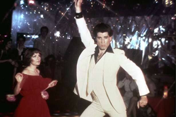 """** FILE ** In this 1977 file photo originally released by Paramount Pictures, John Travolta and Karen Lynn Gorney, left, are shown in a scene from, """"Saturday Night Fever.""""   The Library of Congress announced early Tuesday Dec. 28, 2010 that the film will be preserved by the Library of Congress as part of its National Film Registry.        (AP Photo/Paramount Pictures) ** NO SALES **"""