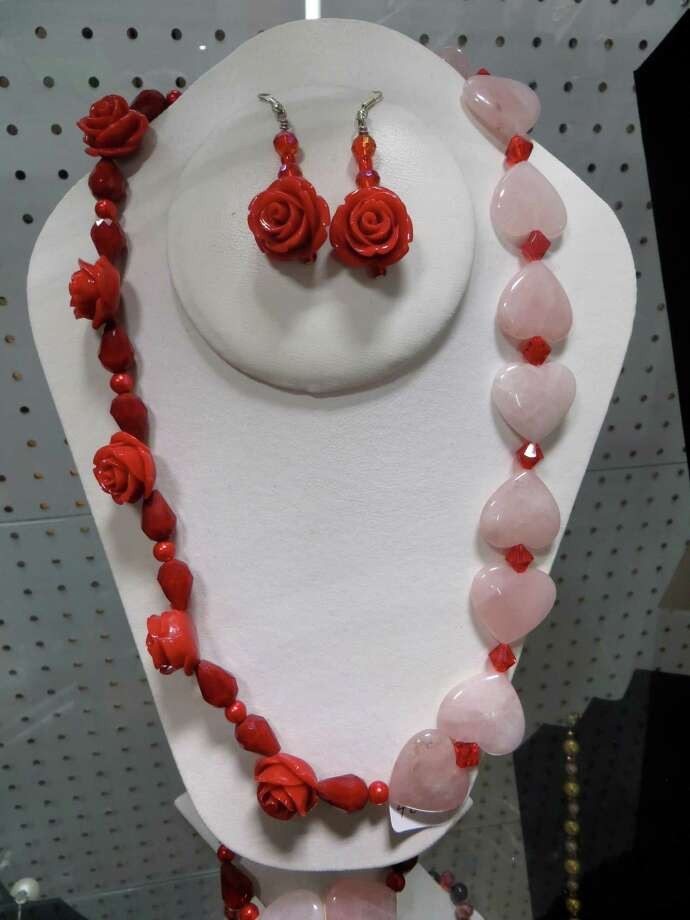 910 SE Military Drive: (Inside Pica Pica Plaza) Sara's Hand Crafted Jewelry: Sara's Hand Crafted Jewelry carries this rose and heart necklace-and-earring set. Photo: Jennifer Rodriguez