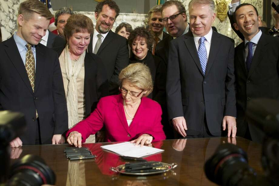 Washington Gov. Chris Gregoire signs marriage equality legislation into law Feb. 13, 2012, less than three months after an emotional Thanksgiving at which she told daughters of her support for it. Photo: Getty Images