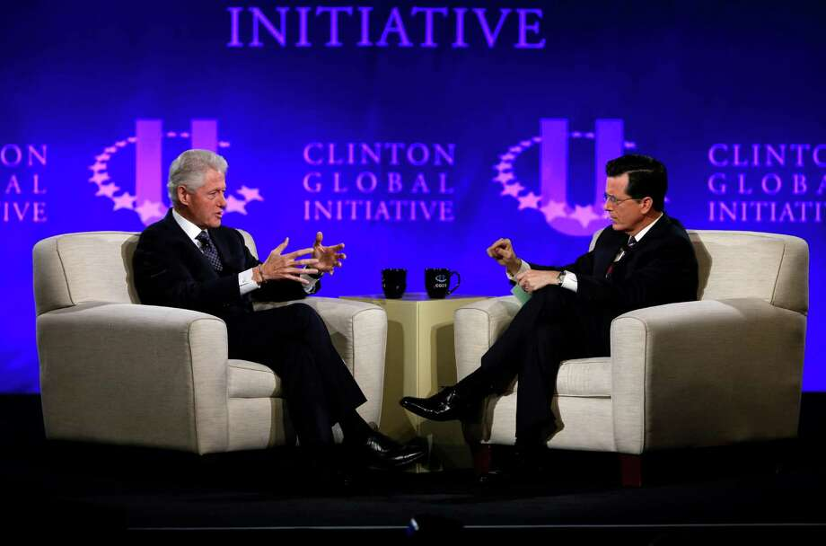 """FILE - This April 6, 2013 file photo shows former President Bill Clinton, left, and Comedy Central's Stephen Colbert during the Clinton Global Initiative at Washington University in St. Louis. More than 1,000 students from 75 countries and all 50 states are gathered for a weekend of sessions seeking practical and innovative solutions to the world's problems. Colbert lured the former president to the social networking site on """"The Colbert Report"""" on Monday, signing him up with the handle PrezBillyJeff. Clinton dictated his first message to Colbert, who typed: """"Just spent an amazing time with Colbert! Is he sane? He is cool!""""  Whether Clinton would continue to use the account remained uncertain. Colbert's hand is clearly in the account's description, too. It reads: """"Stephen Colbert is my BFF.""""  By Tuesday morning, the account had quickly amassed nearly 50,000 followers and was climbing fast.  (AP Photo/Jeff Roberson, file) Photo: Jeff Roberson"""