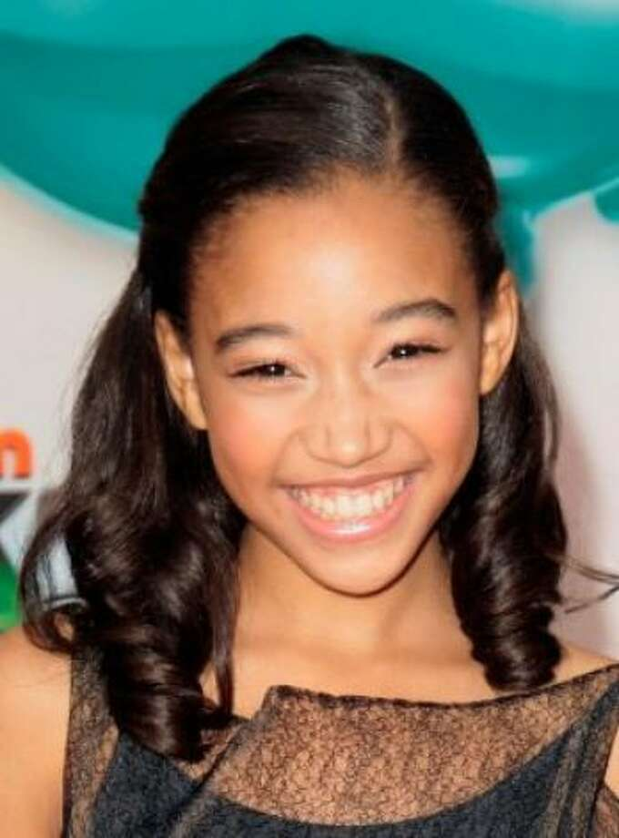 """Rue is the hottest new baby name this year. Amandla Stenberg is the actress who portrays that character in the movie \""""Hunger Games.\""""  (Jason Redmond / Associated Press)"""