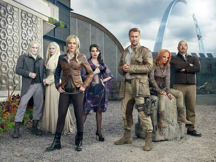 Seven races of aliens have descended on Earth and a town's mayor (Julie Benz), madam (Mia Kirshner), hero (Grant Bowler) and miner (Graham Greene) try to make the best of it in Syfy series 'Defiance'. Photo: Syfy