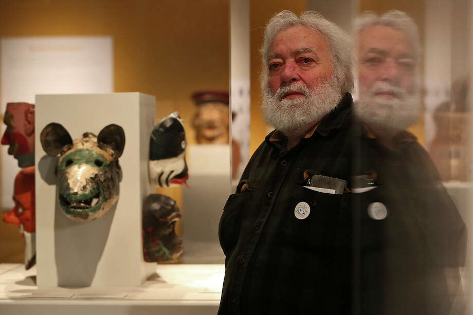 "Collector Peter P. Cecere stands amid his donated collection, ""Pasion Popular,"" a collection of Spanish and Latin American Folk Art, at the San Antonio Museum of Art on Friday, April 5, 2013. Photo: Lisa Krantz, San Antonio Express-News / San Antonio Express-News"