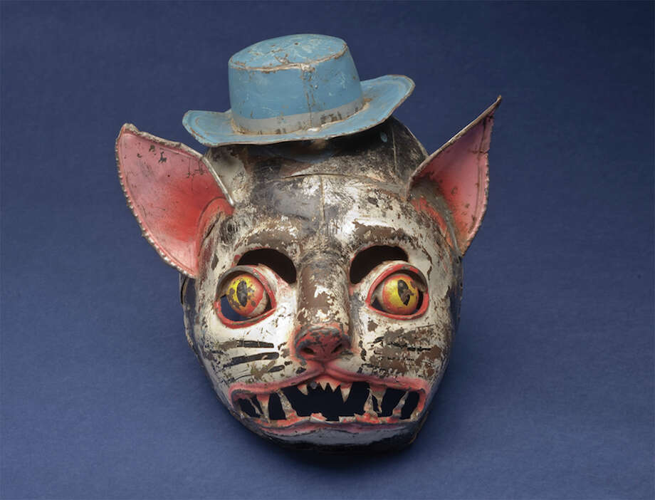 "CAT MASK, ca. 1960 Bolivia Painted tin; 8 ½ x 10 in. San Antonio Museum of Art, Gift of Peter P. Cecere 2006. Photography by Peggy Tenison ""Pasión Popular: Spanish and Latin American Folk Art from the Cecere Collection"" is a new exhibit with 200 objects dating from the 18th century to modern times. Photo: Peggy Tenison / Photography by Peggy Tenison. Contact the San Antonio Museum of Art for Rights and Reproductions."