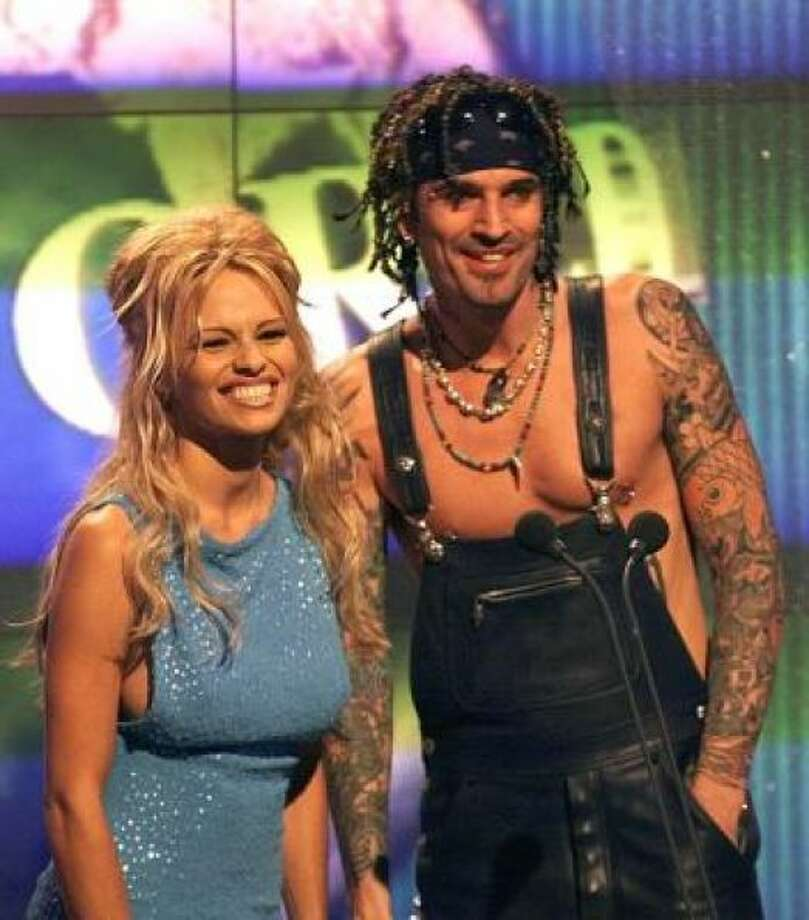 Pamela Anderson Lee and then- husband Tommy Lee settled with the company that received and distributed copies of their allegedly stolen sex tape. Pam was later caught in another sex tape scandal with boyfriend Brett Michaels. Photo: Photo By LIONEL CIRONNEAU/AP