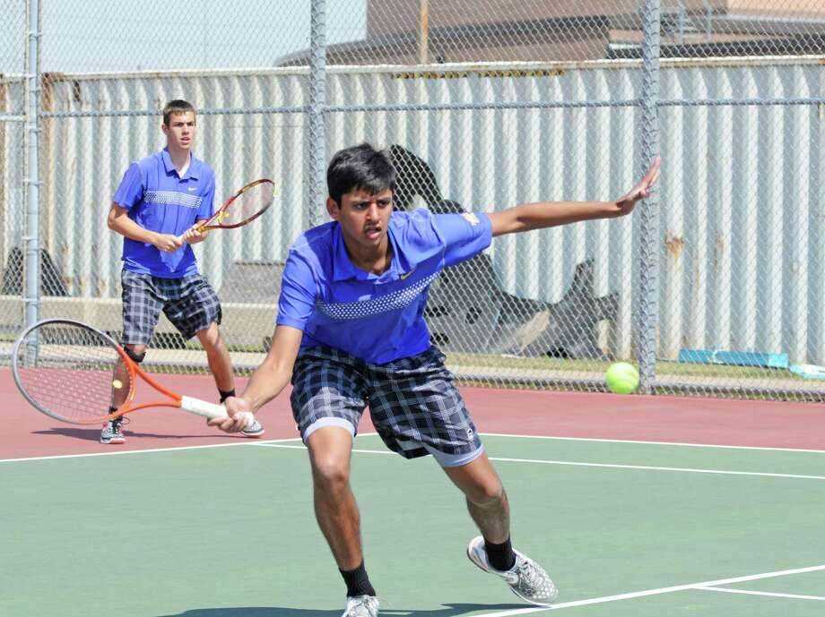 Klein's Travis Lenz (left in background) and Raghunath Kadamangudi will compete in boys doubles at the 2013 Class 5A Region II Tennis Tournament Tuesday and Wednesday, April 16-17, in Waco. Photo: L. Scott Hainline / Freelance