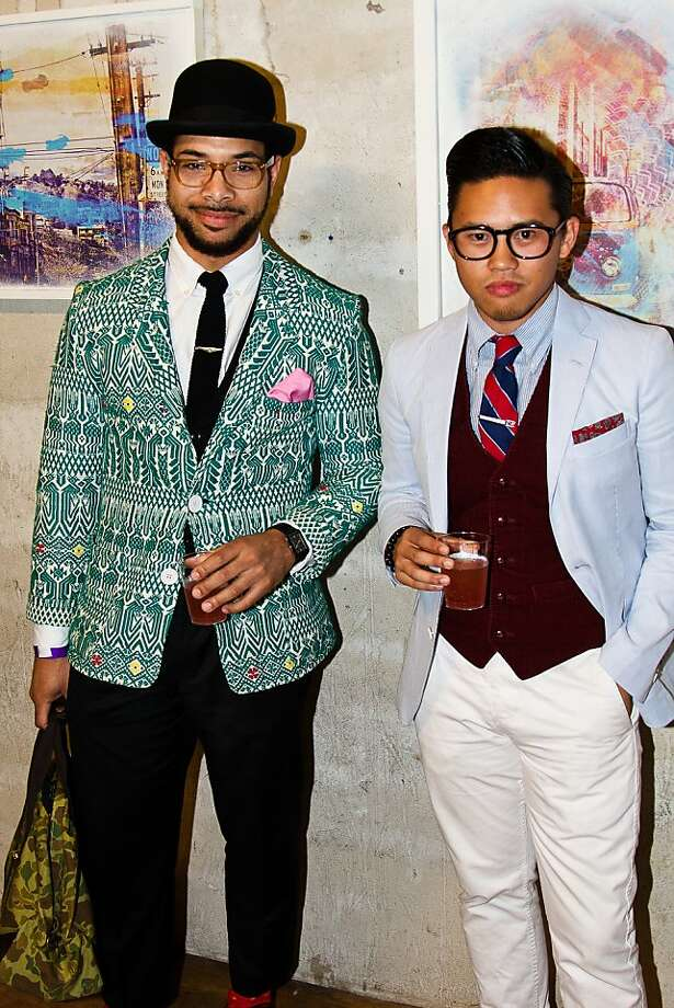 Gentlemen Dario Smith (left) and Tim Taechotirote show off their swanky side at the Art of the Suit event. Photo: Ron Fulcher Photography