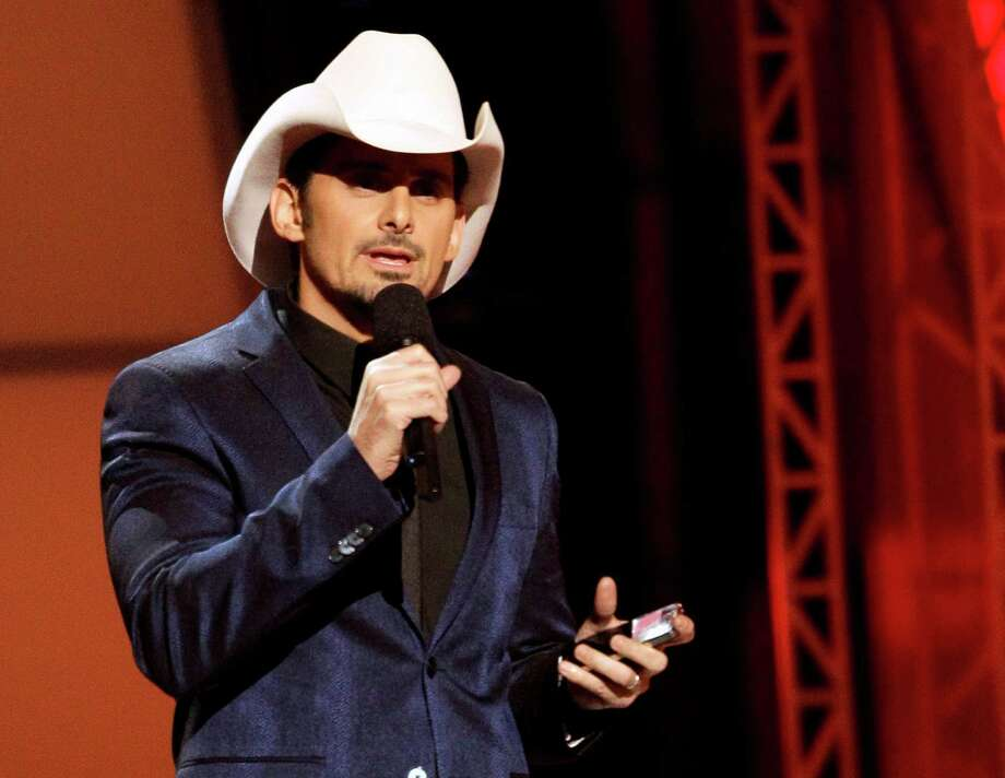 "FILE - This Nov. 1, 2012 file photo shows Brad Paisley hosting the 46th Annual Country Music Awards at the Bridgestone Arena in Nashville, Tenn. Paisley's collaboration with LL Cool J on ""Accidental Racist"" has accidentally kicked up some controversy. The song about racial perception has drawn ire from both the country and urban music worlds after its wide release. (Photo by Wade Payne/Invision/AP, file) Photo: Wade Payne, Associated Press / Invision"