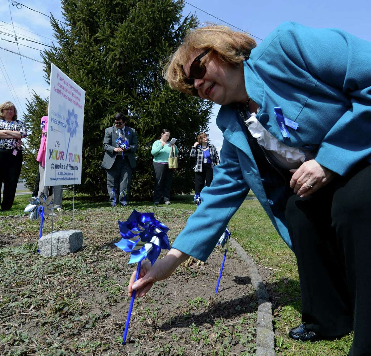 Gladys Carrion, commissioner of the state Office of Children and Family Services, plants the first pinwheel in the Pinwheels for Prevention Garden at Huyck Square on Monday afternoon in Rensselaer, N.Y. Pinwheels for Prevention is the name of the program that donates funds to the prevention of child abuse. (Skip Dickstein/Times Union)