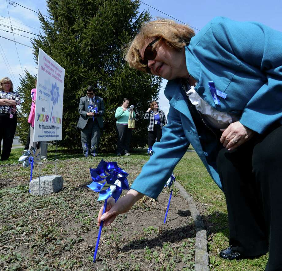 Gladys Carrion, commissioner of the state Office of Children and Family Services, plants the first pinwheel in the Pinwheels for Prevention Garden at Huyck Square on Monday afternoon in Rensselaer, N.Y.  Pinwheels for Prevention is the name of the program that donates funds to the prevention of child abuse.   (Skip Dickstein/Times Union) Photo: SKIP DICKSTEIN / 10021908A
