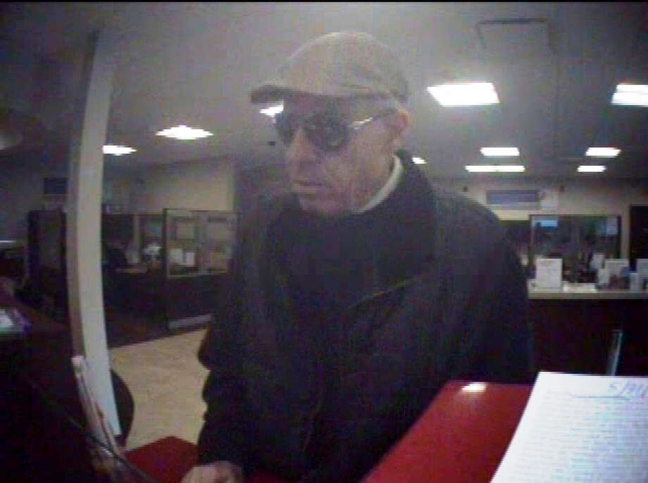 This image was taken during the April 6, 2013, robbery of the KeyBank at 9735 Holman Road Northwest.