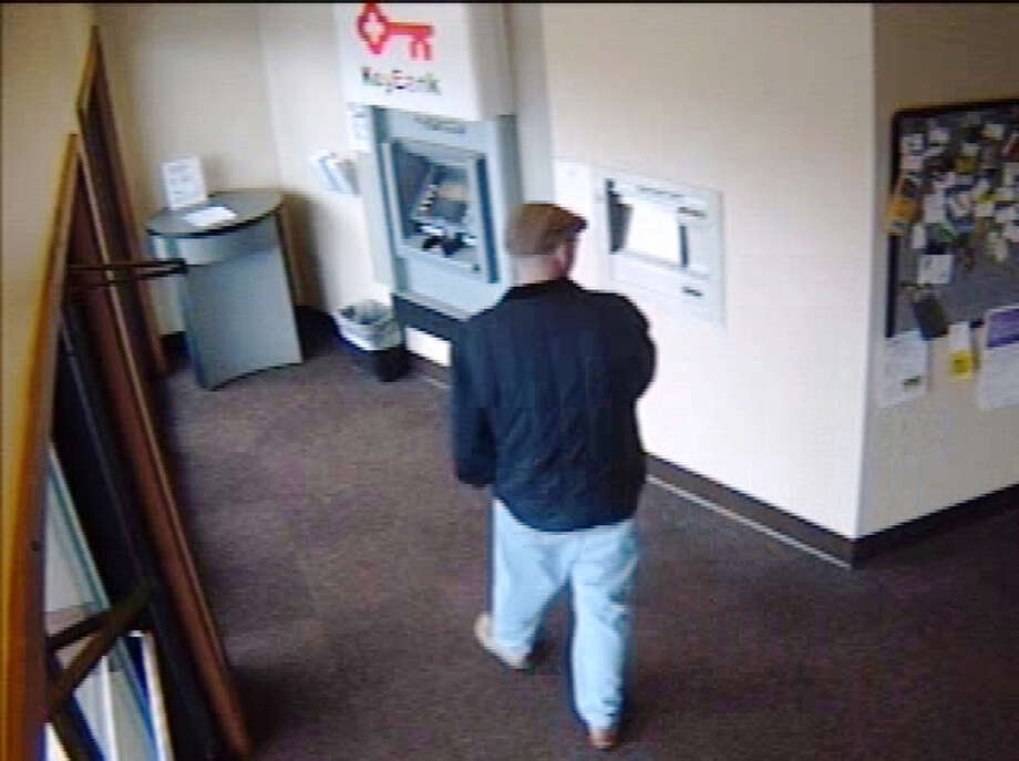 This man is wanted for robbing the KeyBank at 9735 Holman Road Northwest on Saturday, April 6, 2013.