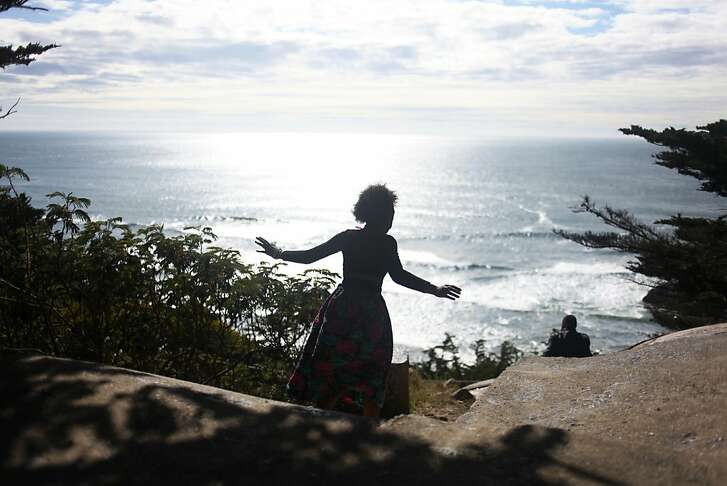 Aaliyah Bey walks towards a cliff and her boyfriend, Jerome Bright, at Sutro Heights on March 26, 2013 in San Francisco, Calif.