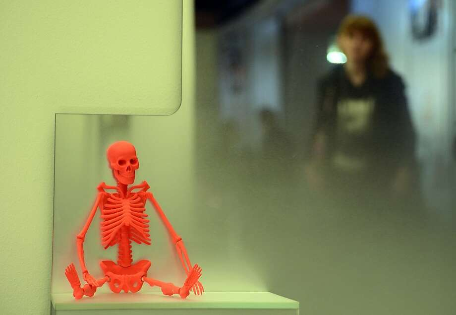 Impulse item: Glas Italia hopes its colorful skeleton dolls will catch shoppers' eyes during Milan's annual furniture fair at the Fiera Milano in Rho. Photo: Olivier Morin, AFP/Getty Images