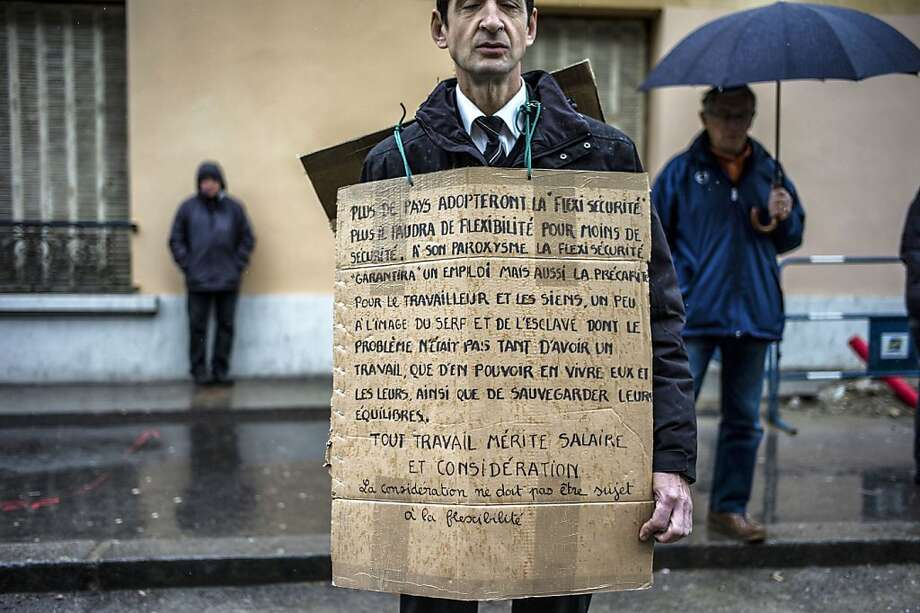 Labor grievance:In Lyon, France, a picket wears a sandwich-style poster while protesting a bill to reform the country's labor laws. Photo: Jeff Pachoud, AFP/Getty Images