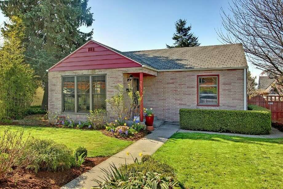 Want an affordable house in Seattle? Try Rainier Beach. Here are three nice homes listed there for $249,000 to $299,000, starting with 9833 61st Ave. S. The 1,100-square-foot house, built in 1943, has two bedrooms, one bathroom, a family room, a two-story finished barn, a back deck and a patio on a 5,650-square-foot lot. It's listed for $249,000. Photo: Courtesy Simone Bouterse/Windermere Real Estate