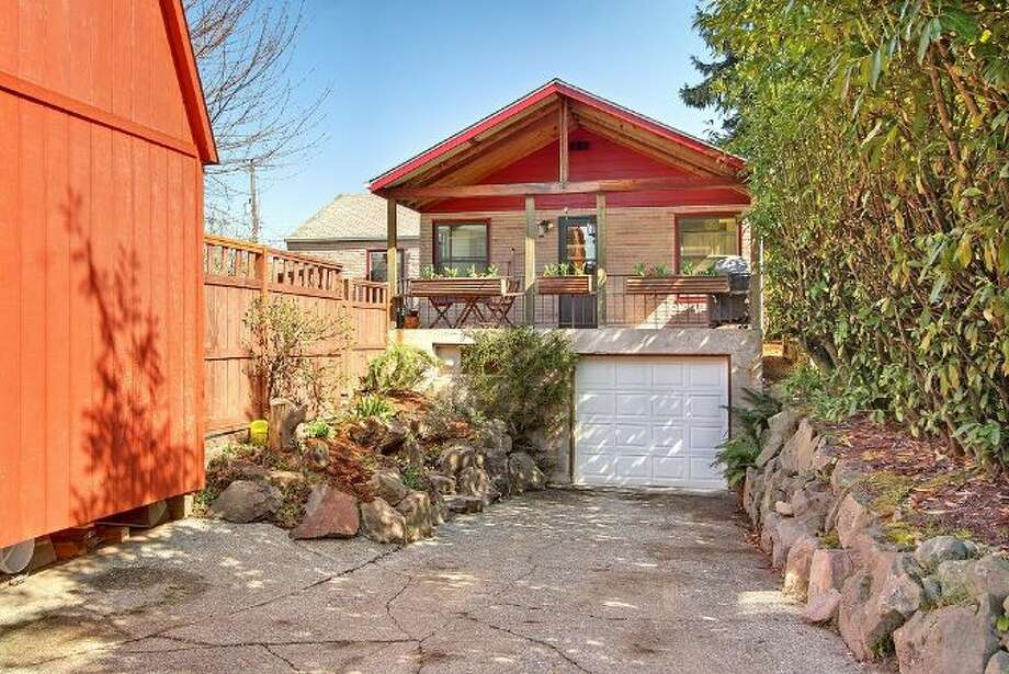 Rear of 9833 61st Ave. S. The 1,100-square-foot house, built in 1943, has two bedrooms, one bathroom, a family room, a two-story finished barn, a back deck and a patio on a 5,650-square-foot lot. It's listed for $249,000. Photo: Courtesy Simone Bouterse/Windermere Real Estate