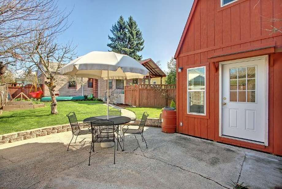 Patio and finished barn of 9833 61st Ave. S. The 1,100-square-foot house, built in 1943, has two bedrooms, one bathroom, a family room and a back deck on a 5,650-square-foot lot. It's listed for $249,000. Photo: Courtesy Simone Bouterse/Windermere Real Estate
