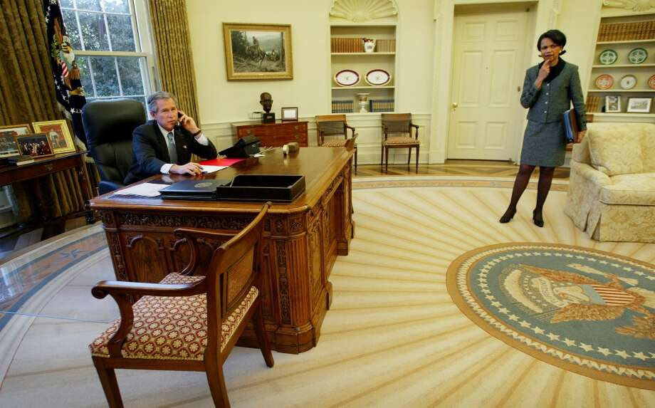 FILE - U.S. President George W. Bush, left, speaks with Spanish Prime Minster Jose Maria Aznar by telephone from the Oval Office of the White House in Washington with National Security Adviser Condoleezza Rice at right on Monday, March 10, 2003 as Bush and his top aides engaged in last-minute telephone diplomacy to world leaders in an uphill struggle to gain support for a U.N. resolution setting up war against Iraq. (AP Photo/Pablo Martinez Monsivais, File) Photo: Pablo Martinez Monsivais, Associated Press / AP