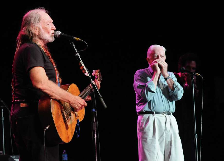 "(EXCLUSIVE, Premium Rates Apply) ATLANTA - JULY 27:  ****EXCLUSIVE  COVERAGE*****                                  Willie Nelson is joined on stage by Former President Jimmy Carter who plays harmonica on ""Georgia on my Mind"" The former President and Willie are long time friends. Willie Nelson on tour with B.B. King at Chastain Park Amphitheater, July 27, 2008 in Atlanta Georgia ****EXCLUSIVE COVERAGE*****  (Photo by Rick Diamond/WireImage) Photo: Rick Diamond, Getty / 2008 WireImage"