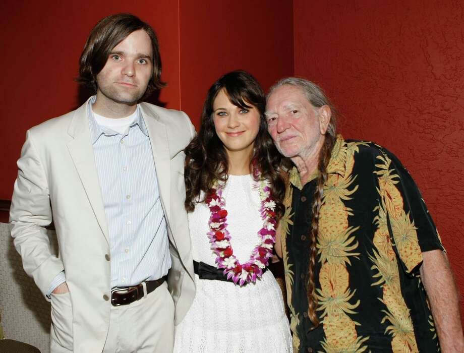 WAILEA, HI - JUNE 18:  (L-R) Death Cab for Cutie frontman Ben Gibbard, actress Zooey Deschanel and country legend Willie Nelson attend Shep Gordon's Party during the 10th Annual Maui Film Festival at Mala on June 18, 2009 in Wailea, Hawaii. Photo: Michael Buckner, Getty / 2009 Getty Images