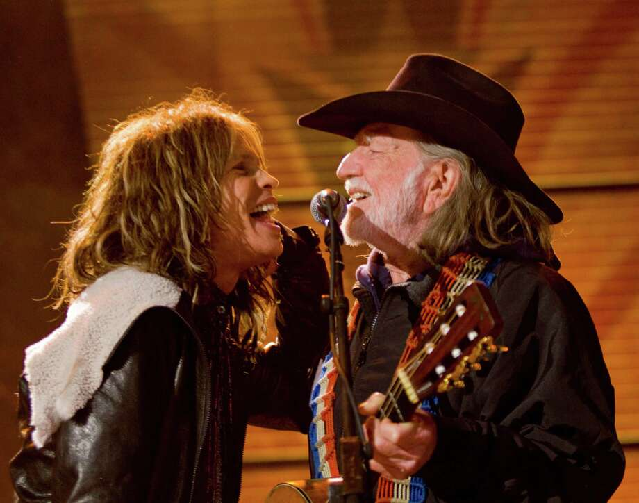MILWAUKEE, WI-  OCTOBER 02:  Steven Tyler (L) and Willie Nelson on stage at Farm Aid 25: Growing Hope for America at Miller Park on October 2, 2010 in Milwaukee, Wisconsin. Photo: Darren Hauck, Getty / 2010 Getty Images