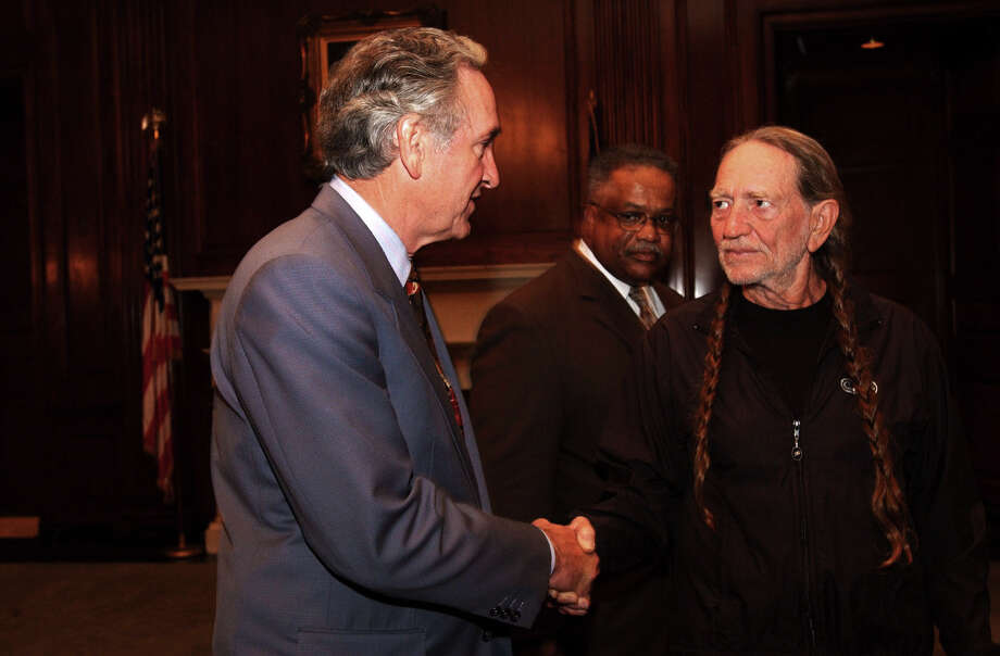 UNITED STATES - JULY 26:  Tom Harkin and Willie Nelson during a press conference on farm aid. Nelson who was in town for a concert stoped by to see Harkin and to help the Senator with calling attention to problems that american farmers are facing. Photo: Douglas Graham, Getty / Roll Call