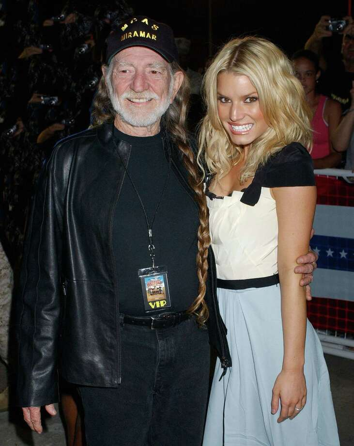 "Willie Nelson and Jessica Simpson during ""The Dukes Of Hazzard"" Stars Visit Marine Corps Air Station Miramar at Marine Corps Air Station Miramar in San Diego, California, United States. (Photo by Gregg DeGuire/WireImage) Photo: Gregg DeGuire, Getty / WireImage"