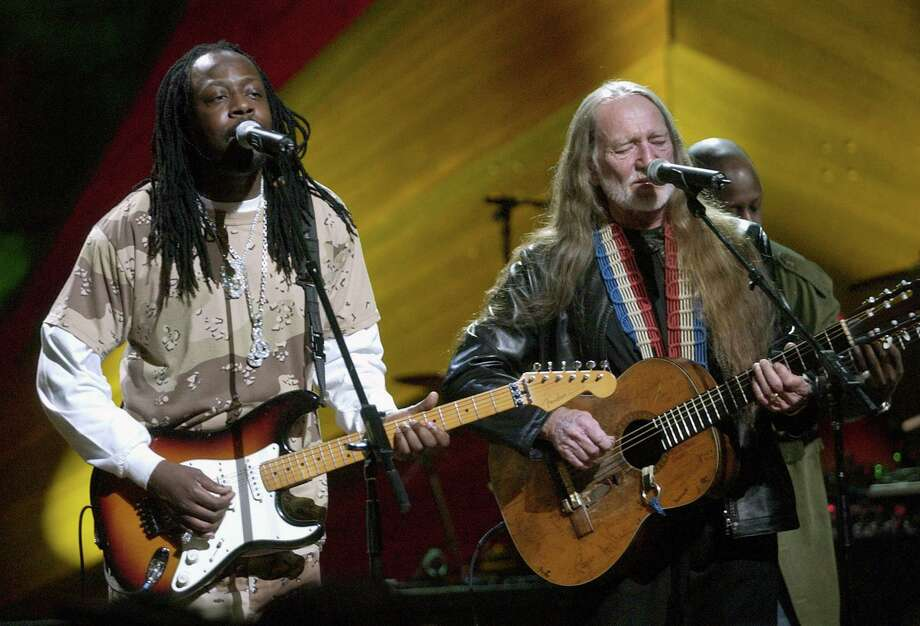 "Wyclef Jean and Willie Nelson during ""Willie Nelson and Friends: Live and Kickin'"" Premieres on USA Network May 26, 2003 - Show at Beacon Theatre in New York City, New York, United States. (Photo by KMazur/WireImage) Photo: KMazur, Getty / WireImage"