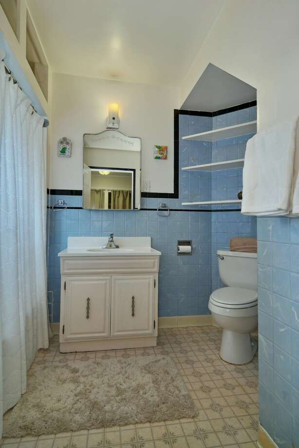 Bathroom of 5349 S. Creston St. The 1,910-square-foot home, built in 1919, has three bedrooms, two bathrooms, a rec room, a back deck and a terraced, 8,162-square-foot lot. It's listed for $264,000. Photo: Stefan Enriquez/Courtesy Robin Tomazic/RE/MAX Metro Realty