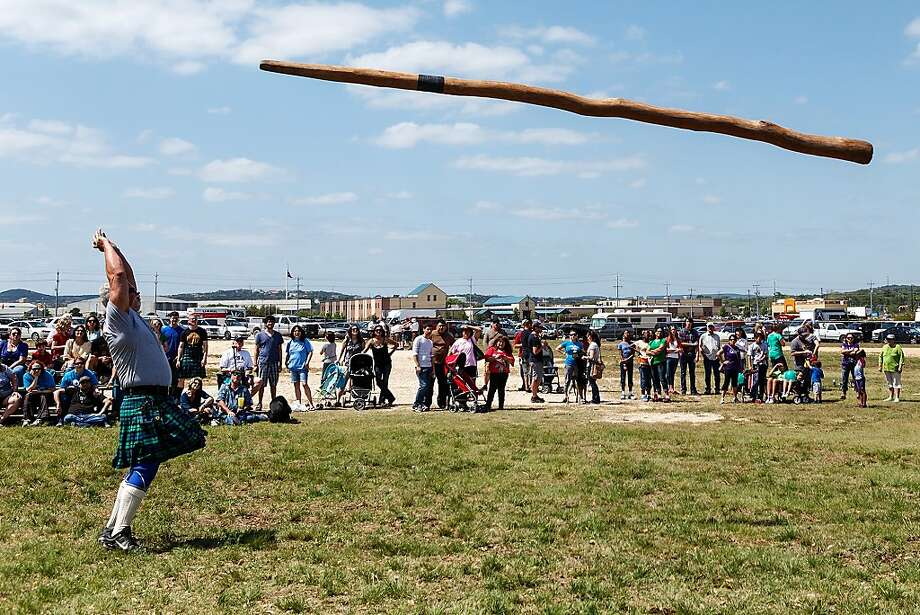 Kiltie pleasures: Rich Campbell competes in the Caber Toss, which is basically throwing a telephone pole - during the San Antonio Highland Games & Celtic Music Festival. Photo: Prime Time Newspapers, Marvin Pfeiffer