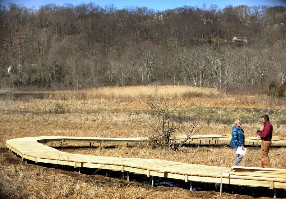 No. 1: Sherman has 87 men per 100 women.  Marge Josephson, president of the Naromi Land Trust, and contractor Peter Jensen, discuss the boardwalk they\'re building on the Wimisink Swamp Reserve in Sherman, Conn. Thursday, April 4, 2013.