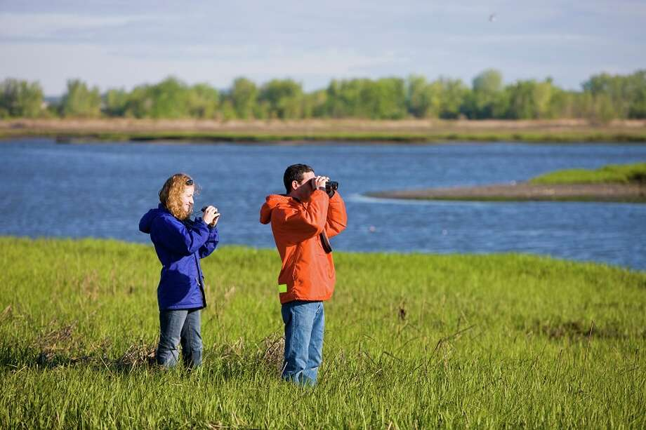 No. 4: Stratford has 90.4 men per 100 women.  A young couple watches for wildlife on the salt marsh side of Long Beach in Stratford, Connecticut.  This body of water is known as Lewis Gut and is adjacent to the Great Meadows Unit of McKinney National Wildlife Refuge. Photo: Jerry And Marcy Monkman, Jerry And Marcy Monkman/Green Stock Media / © Jerry and Marcy Monkman. All rights reserved.