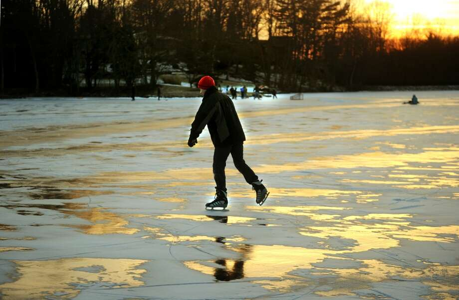 No. 7: Trumbullhas 91.2 men per 100 women.  Skaters take to the ice the sun sets over Canoe Brook Lake in Trumbull on Sunday, January 27, 2013.