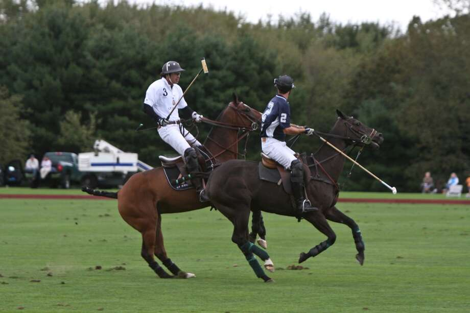 No. 10 (Tie): Greenwich has 93 men per 100 women.  GREENWICH, CT - SEPTEMBER 17:  Polo player and St. Regis Connoisseur Nacho Figueras (L) competes at the St. Regis 1904 Polo Cup at Greenwich Polo Club on September 17, 2011 in Greenwich, Connecticut.  (Photo by Chelsea Lauren/Getty Images for Starwood)