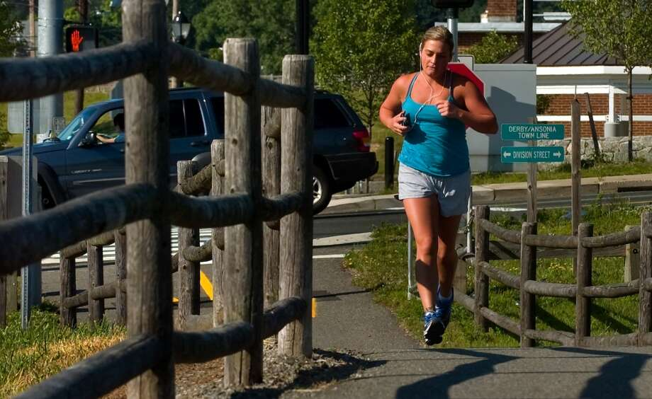 No. 19: Derbyhas 95.1 men per 100 women.  Julie Mastrianni, of Derby, jogs along a portion of the Naugatuck River Greenway in Derby, Conn. on Thursday June 28, 2012.