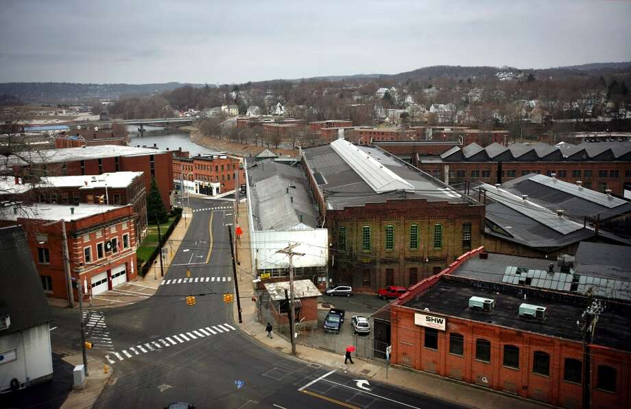 No. 23: Ansoniahas 97.2 men per 100 women.  A view down Main Street in downtown Ansonia with the Farrel factory, right, and Riverside Apartments project in the distance across the Naugatuck River.