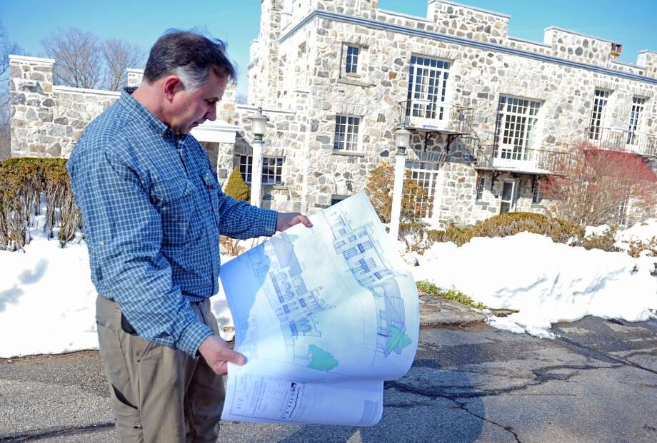 No. 28: Monroe has 99.6 men per 100 women.  John Kimball, CEO of The Kimball Group, looks over blueprints for The Stone Castle on the Sisters of the Holy Family of Nazareth property at 1428 Monroe Turnpike in Monroe, Conn. which he plans to renovate.